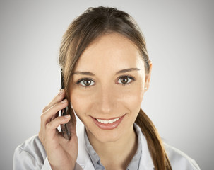 young medical woman calling by mobile phone