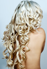 Beautiful  blond long curly hair /woman