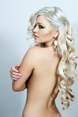 Blonde curly woman with yellow make up