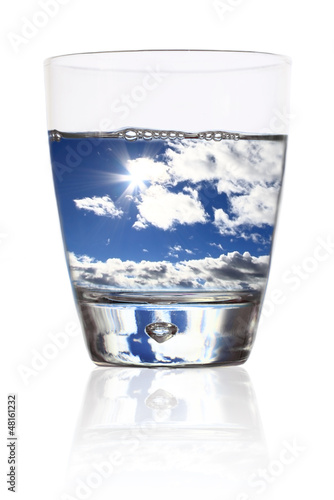 Glass of life. Cloudy sky in a glass of water
