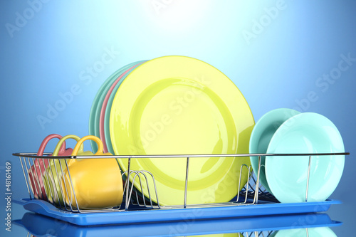 Color plates in rack on blue background