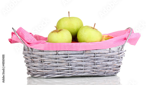 Ripe apples in basket isolated on white