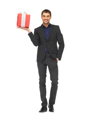 handsome man in suit with a gift box