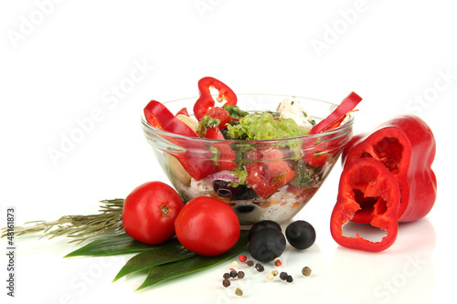 Fresh greek salad in glass bowl isolated on white