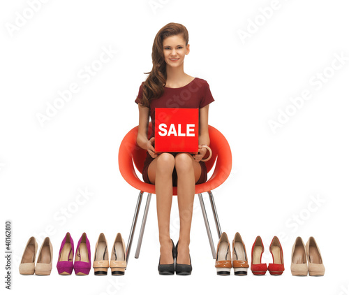 teenage girl in red dress with shoes and sale sign