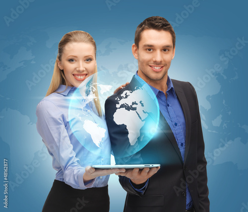 man and woman with tablet pc and virtual globe