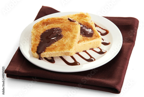 White bread toast with chocolate on plate, isolated on white