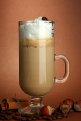 Fragrant coffee latte in glass cup with spices,