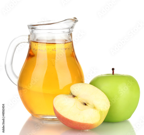 Full jug of apple juice and apple isolated on white