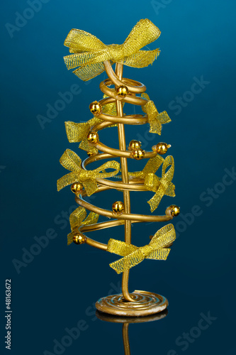 Wire Christmas tree on blue background