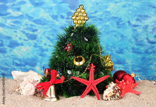 Christmas tree on sand in beach