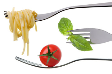 spaghetti basil and tomato on forks isolated