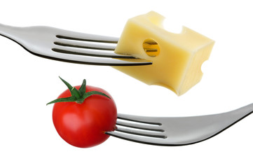 tomato and cheese on a fork against white background