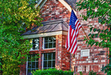 American flag hanging on the front of the house - 48165831