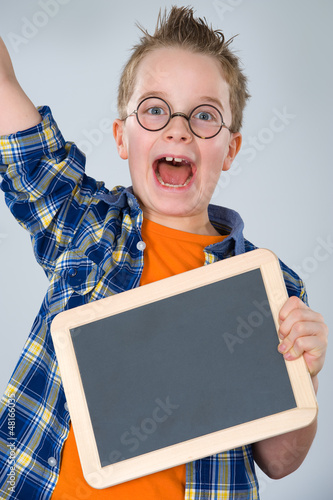 happy boy with little blackboard