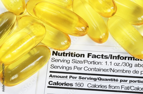 Nutrition label with fish oil pills concept healthy eating