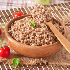 Buckwheat porridge in a wooden bowl