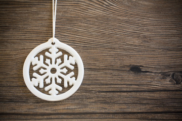 Snowflake on a wooden background