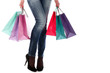 Shopping bags near legs in jeans