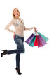 Young beautiful woman holds bags and smiling