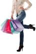 Shopping bags near legs in jeans