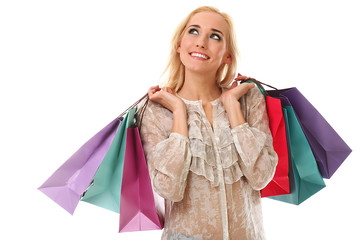 Young beautiful woman holds shopping bags