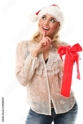 Young woman in red christmas cap holding gifts