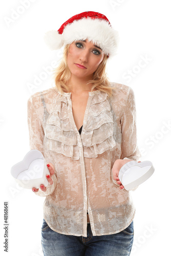 Unhappy young woman in christmas cap