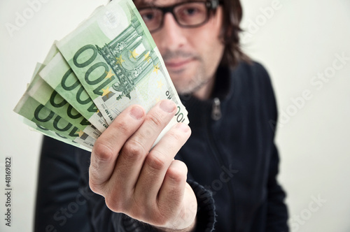 Man paying in euros