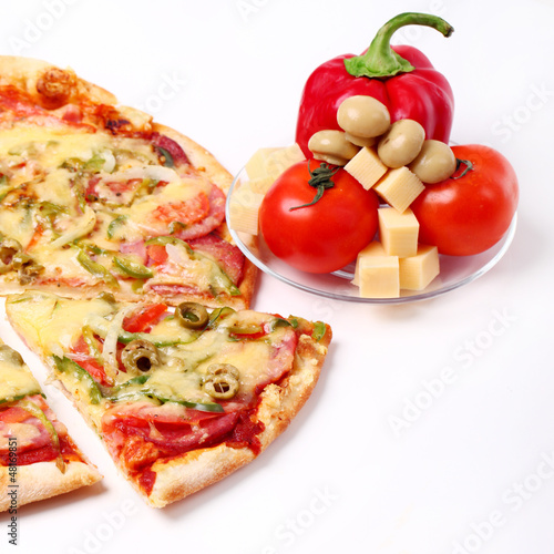 Image of sliced pizza and vegetables  isolated