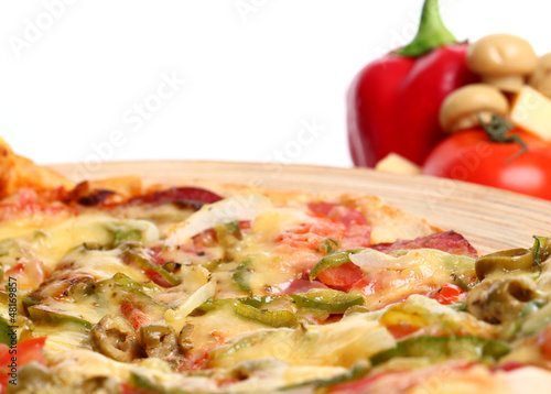 Image of sliced pizza in a plate and vegetables