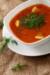 Image of bowl of hot red soup served with parsley