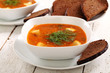 Image of bowl of hot red soup and black bread
