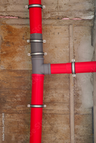 Red plastic water pipes