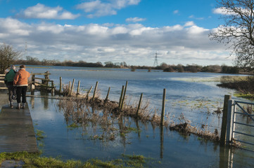 Flooded footpath next to river