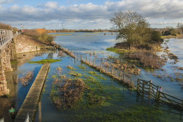 Flooded footpath, walkway on the river Nene Cambridgshire