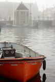 orange vessel on canal in Leiden