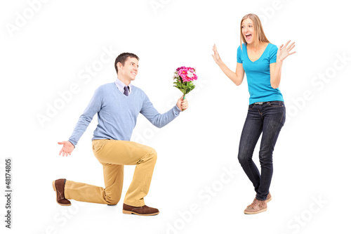 A romantic male with bouquet of flowers and his girlfriend