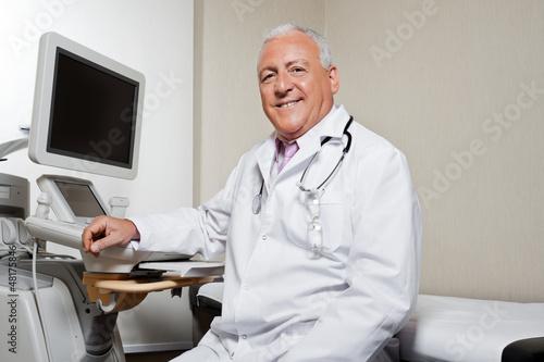 Radiologist Sitting By Ultrasonic Machine