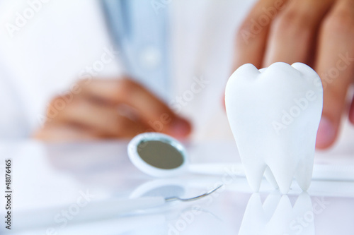 dentist holding molar,dental concept