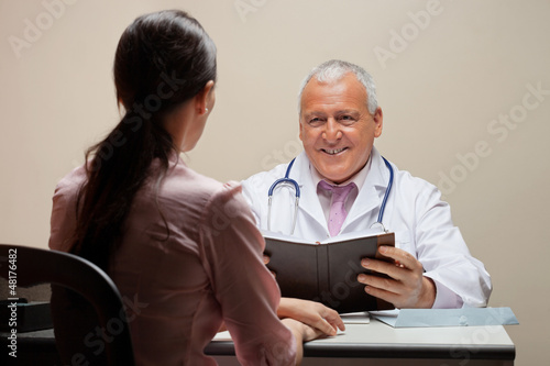 Doctor Looking At Patient