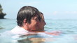 Lovely couple swimming and hugging in ocean