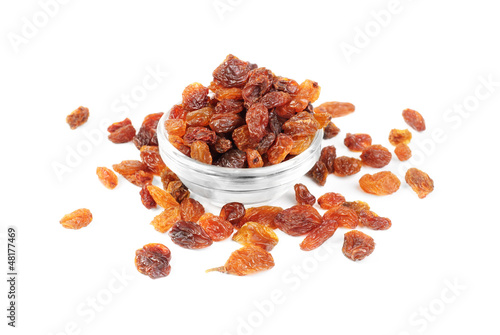 raisins close- up in glass bowl isolated on white background
