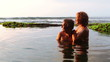 Loving couple hugging in Bali lagoon  while summer vacation