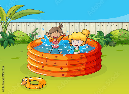 Girls playing in swimming pool