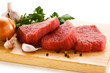 Raw beef on cutting board