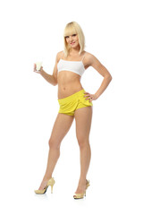 Attractive athletic girl drinks milk