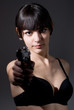 Young woman holding a gun