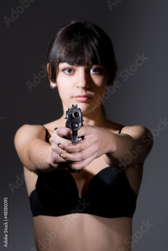 Beautiful sexual girl brunette with gun