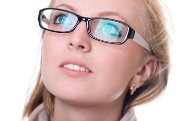 Close-up portrait of a girl with glasses facing upward